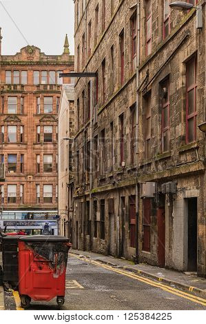 GLASGOW SCOTLAND APRIL 2 2016: A typical backstreet alleyway in the Scottish city of Glasgow on 2nd April 2016.