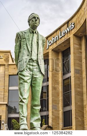 GLASGOW SCOTLAND - APRIL 02 2016: The statue of Donald Dewar that stands outside the Glasgow Royal Concert Hall in Buchannan Street.