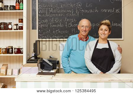 Two deli business owners behind the counter
