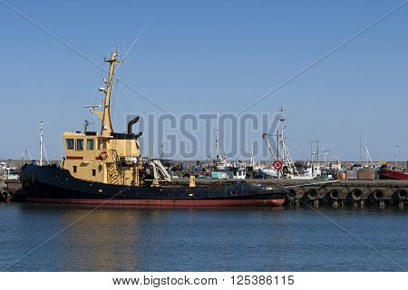 Tugboat in port at Hirtshals Denmark. Copy space