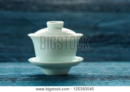 Aquamarine gaiwan chinese teaware on blue background copyspace ** Note: Soft Focus at 100%, best at smaller sizes