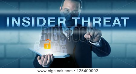 White collar employee is pressing INSIDER THREAT on a virtual touch screen interface. Business challenge metaphor and information technology concept for an insider-caused data loss.