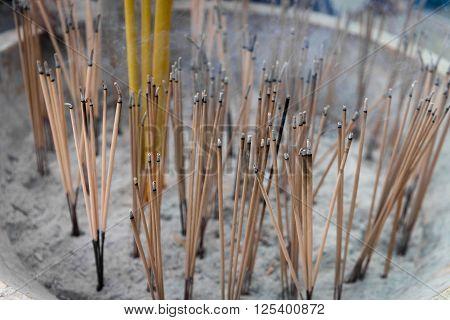 Joss Sticks Smolder On A Buddhist Altar In A Temple