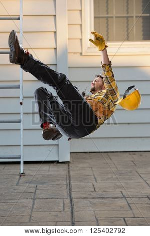 Worker falling from ladder onto floor