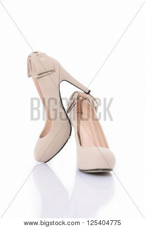 Pair of beige women's high-heeled shoes isolated