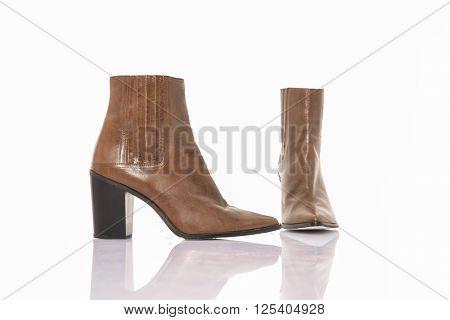 Women's autumn ankle boots black zip average heels, isolated