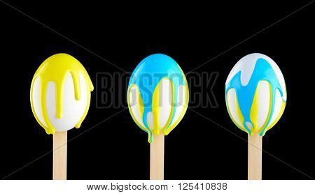 Eggs On A Wooden Stick Doused With Paint