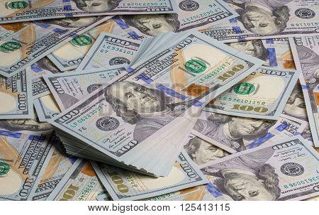 Bundle of dollars banknotes on 100 dollars background