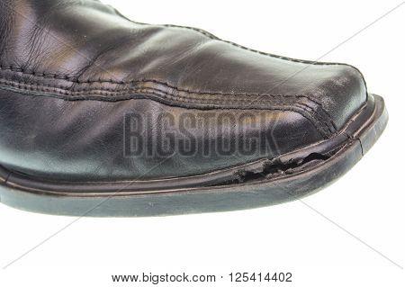 Broken black shoe isotaled on a white background