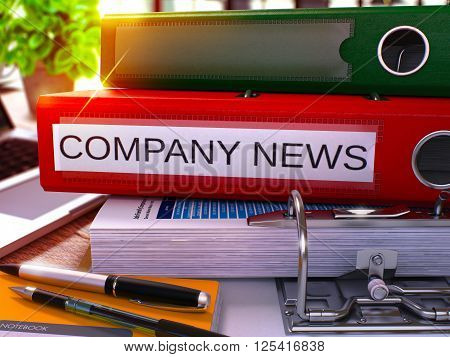 Red Ring Binder with Inscription Company News on Background of Working Table with Office Supplies and Laptop. Company News Business Concept on Blurred Background. 3D Render.