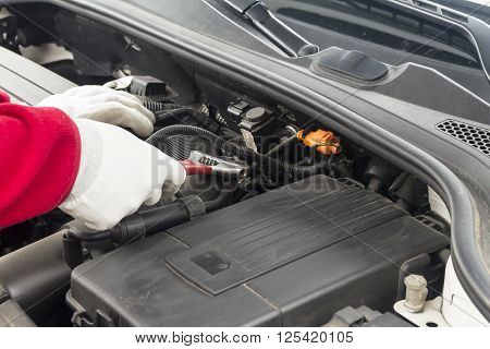 Mechanician Performing Maintenance On A Car Engine