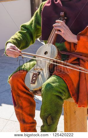 Unrecognizable Musician Playing Rebec