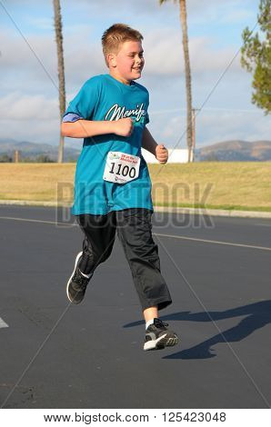 April 9 2016:Photo of runner running in the Menifee Half Marathon & 5K which is in Menifee California USA