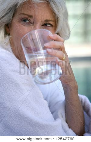 Portrait of a senior woman drinking a glass of water