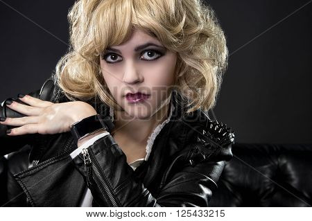 Female wearing dark goth leather style with matching black smartwatch wearable tech
