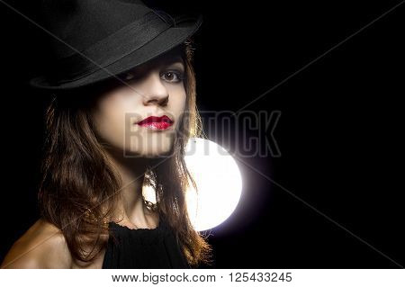Actress with classic smoky dark make up in Hollywood film noir style
