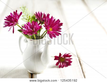 Bouquet of chrysanthemum on wooden table, copy space
