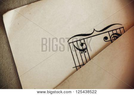Vintage music symbols on ephemera as background
