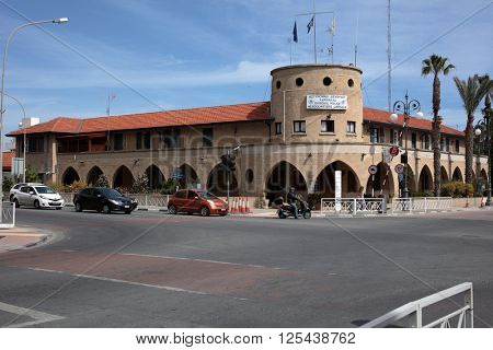 LARNACA, CYPRUS - MARCH 12, 2016: Traffic in front of the central police station. Larnaca is the third largest city of Cyprus