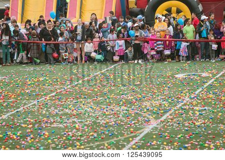 MARIETTA, GA - MARCH 2016: Children and families eagerly await the start of a massive community Easter egg hunt on a local high school football field in Marietta GA on March 26 2016.