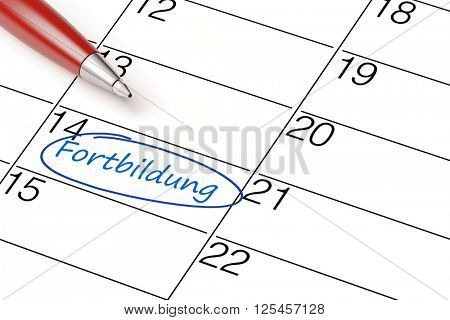 Pen marking date with German text