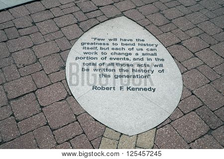 PLAINFIELD, ILLINOIS / UNITED STATES - SEPTEMBER 20, 2015: An inspirational quote by Robert F. Kennedy is displayed on a brick sidewalk in Settlers' Park in Plainfield.