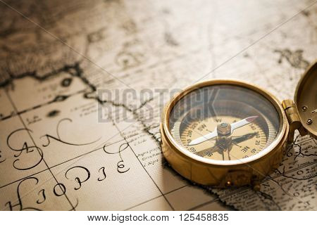 Compass on vintage map