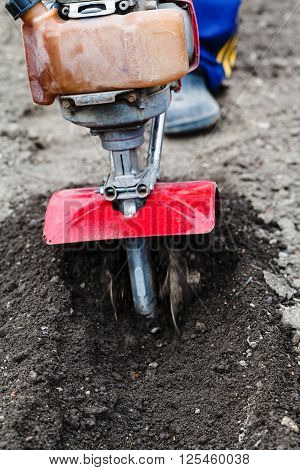 Farmer Plows Field By Tiller In Spring