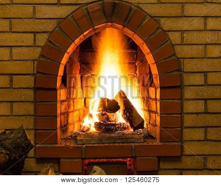 Spurts Of Fire In Brick Fireplace