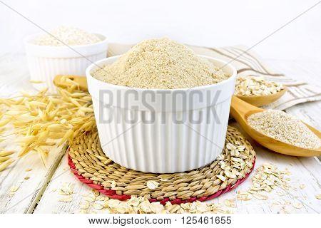 Flour Oat In White Bowl On Board