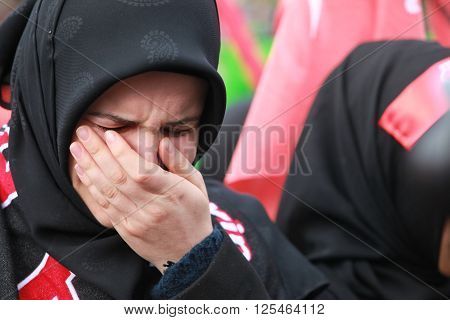 ISTANBUL, TURKEY - NOVEMBER 24, 2012 : Shiite mourners offer afternoon prayer during Chehlum Procession of Hazrat Imam Hussain (AS) on November 24, 2012, in Istanbul,Turkey.