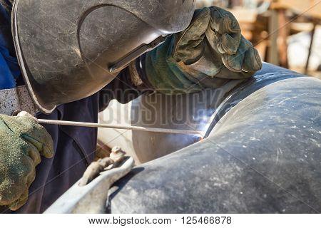 Welder Performs Welding Works On Pipelines Stainless Steel