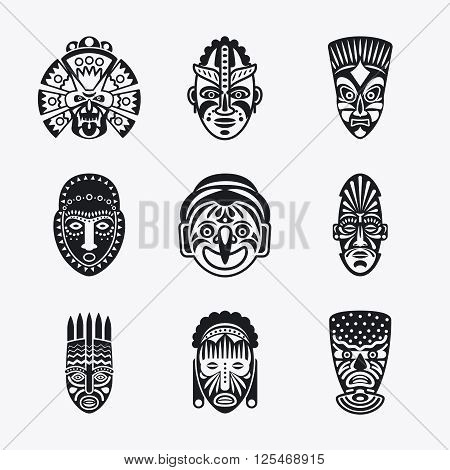Tribal mask icons. Monochrome ethnic masks vector images on white background