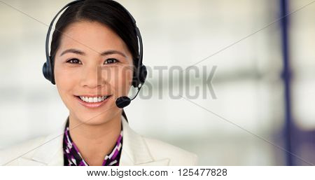 Attractive female engineer smiling at the camera against pies on a wooden table