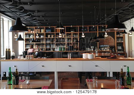 VILNIUS, LITHUANIA - JULY 21, 2015: People in the modern cafe with cozy interior and with open kitchen, Vilnius, Lithuania.