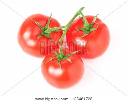branch of three tomatoes isolated on white background.