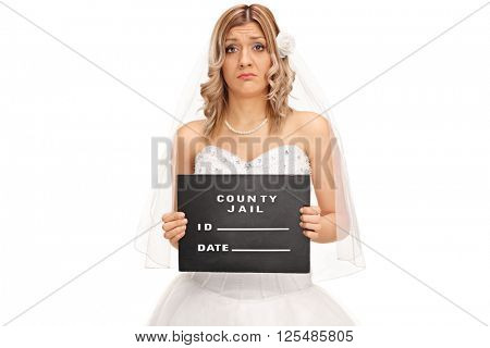 Studio shot of a sad young bride posing for a mug shot isolated on white background