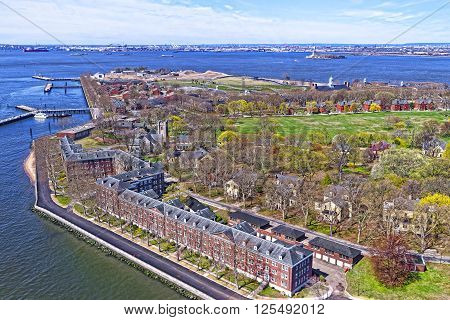 Aerial view from helicopter on Governors Island in Upper New York Bay. New York City USA. Liberty Island is on the background