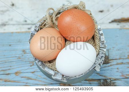 Stock Photo - Mixed eggs on blue background