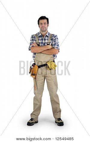 Workman with arms crossed on white background