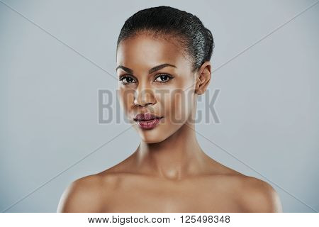 Lovely Woman With Bare Shoulders Over Gray