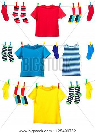 Colorful t-shirt and socks hanging on the clothesline. Image isolated on white background