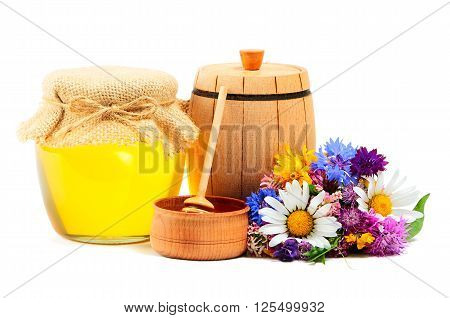 May honey in jar with miscellaneous flowers on white background