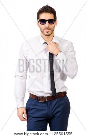 Portrait of a confident businessman in white shirt and sunglasses. Men's beauty, fashion. Isolated over white.