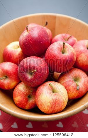 Red Apples In A Wooden Bowl On A Table