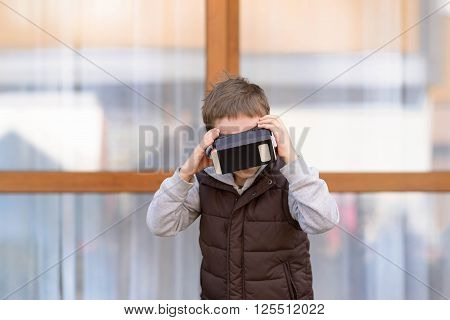 Little Boy Using Vr Virtual Reality Goggles