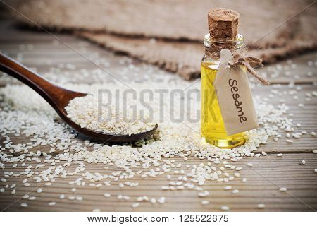 Oil Of Sesame Seeds In A Bottle With A Sign