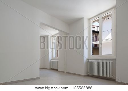 renovated old house, empty room with withe walls, interior