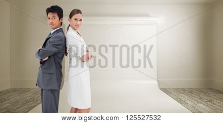 Portrait of business people standing back-to-back against large white screen