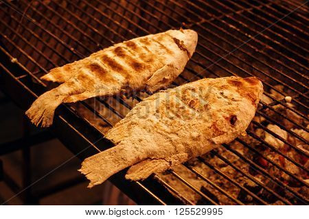 Fish Is Cooking On Grill Grid